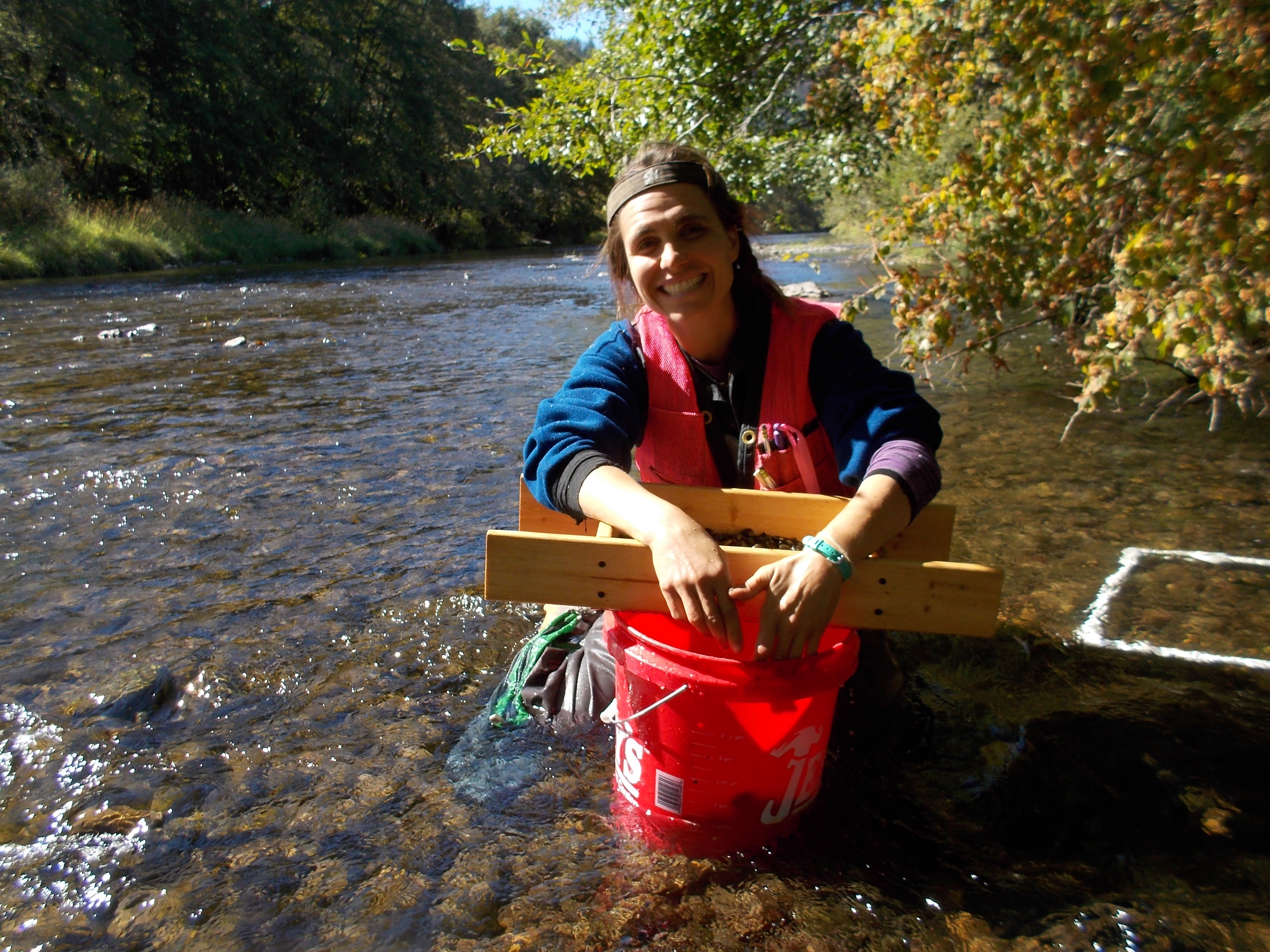April Dawne sampling soil excavated from a quadrat. Juvenile mussels are often embedded in the substrate.
